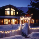 The Alpine House Lodge & Cottages logo