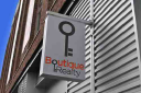 Boutique Realty LLC logo
