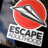 Escapeadulthood.com logo