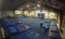 Lawrence Gymnastics Academy logo